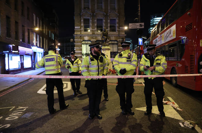 Police officers cordon off the scene in the south side of London Bridge.