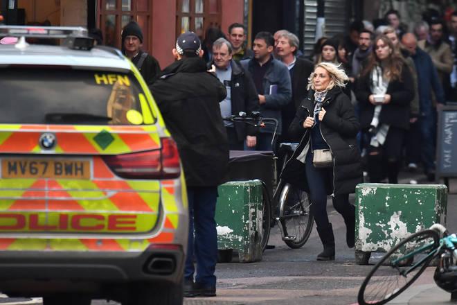 Police ask people to leave the area near Borough Market, London Bridge