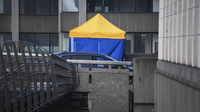 A police tent at the scene today where the attacker was shot dead