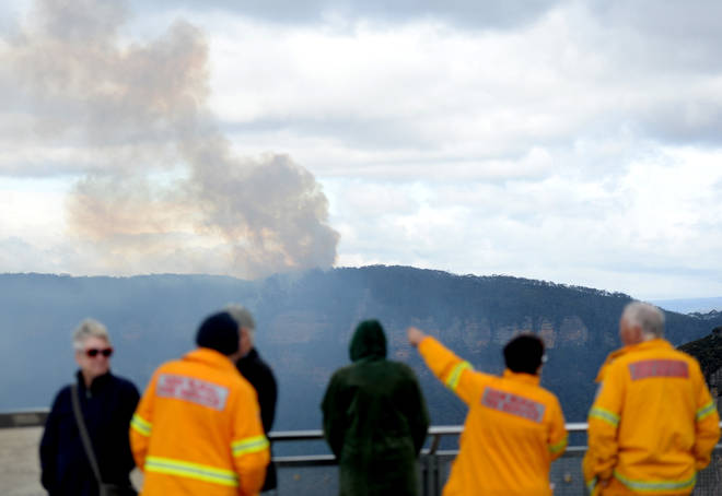 Smoke is seen as a fire continues to burn in Katoomba, Blue Mountains, Sydney