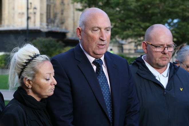 Harry Dunn's mother Charlotte Charles and father Tim Dunn with family spokesman Radd Seiger (centre)