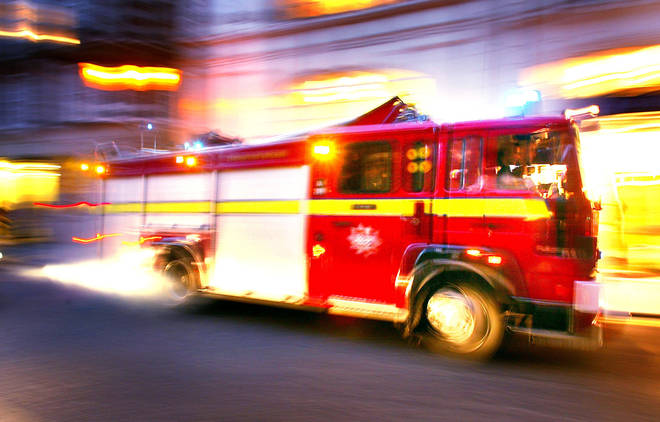 A fire engine races to an emergency call