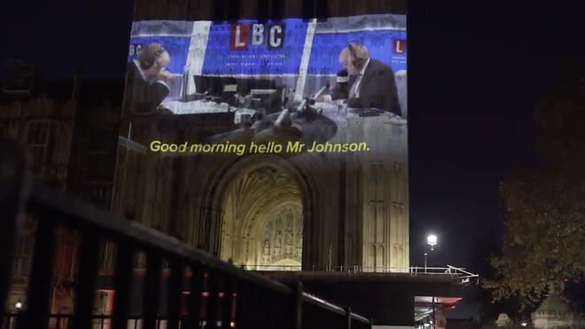 Campaigners project Boris Johnson's LBC interview on to Houses of Parliament