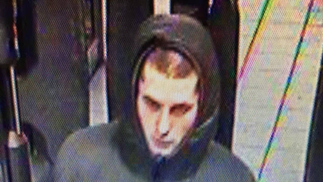 Police released a second image of the man at an underground station