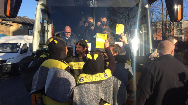 Protesters attached to the Lib Dem bus