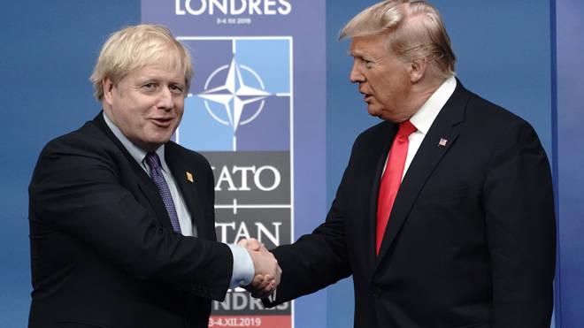 Donald Trump shakes hands with Boris Johnson at the Nato summit today
