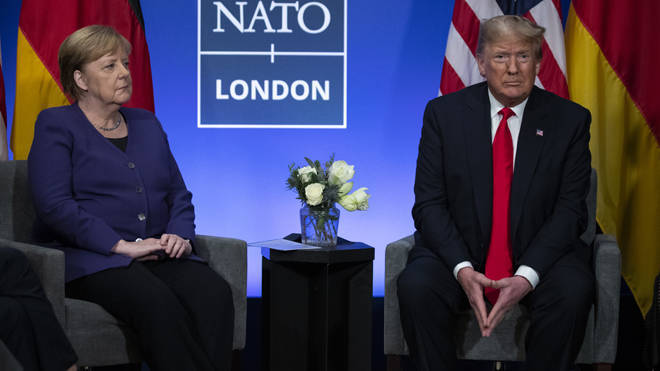 Donald Trump left the Nato summit, calling Justin Trudeau 'two-faced'