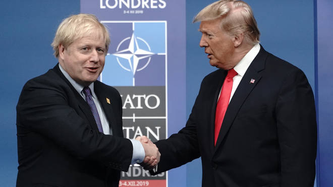 Donald Trump shakes hands with Boris Johnson at the Nato summit today
