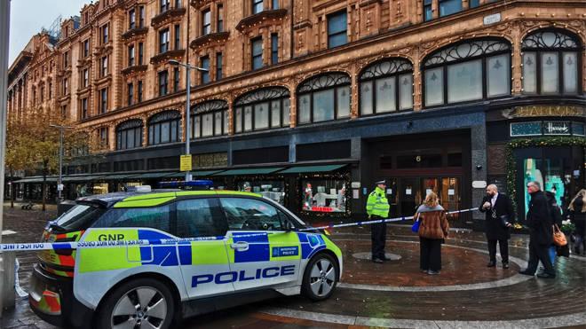 Police at the scene of the stabbing in Knightsbridge outside Harrods