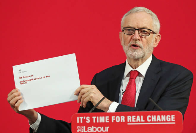 Jeremy Corbyn holds up the leaked document