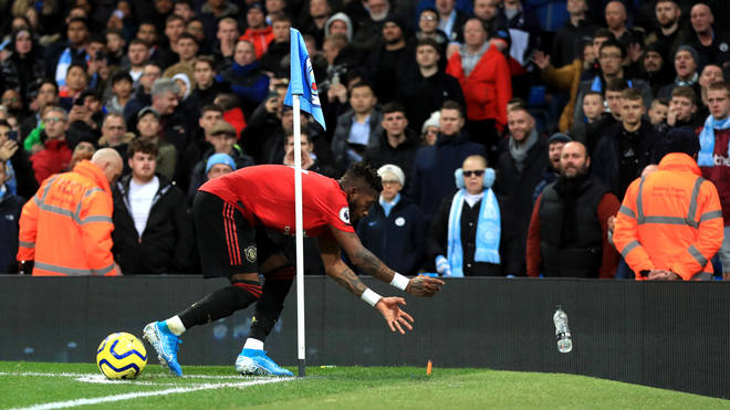 Manchester United's Fred reacts after objects are thrown at him during the Premier League match