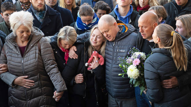 Jack Merritt's mother Anne (far left), girlfriend Leanne O'Brien (centre left) and father David (centre right) during a vigil