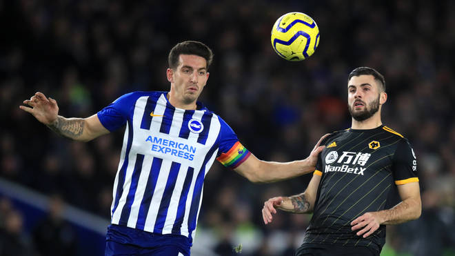 Brighton and Hove Albion's Lewis Dunk (left) and Wolverhampton Wanderers' Patrick Cutrone
