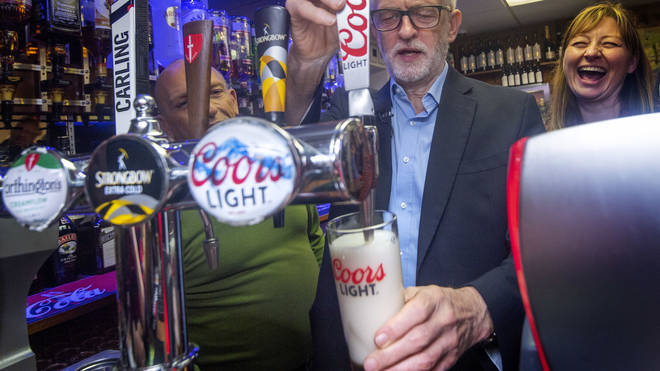 Labour leader Jeremy Corbyn attempting to pull a pint