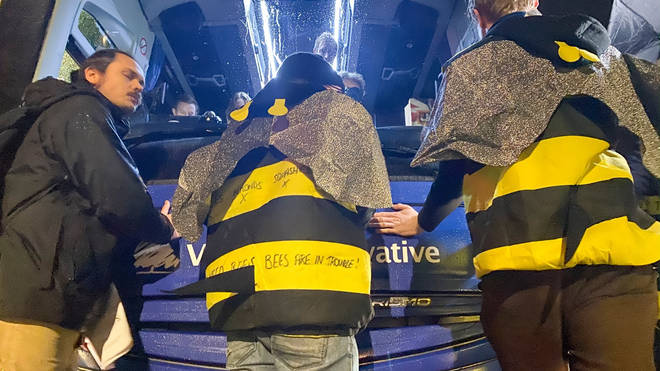 Three of the eight protesters glued themselves to the bus