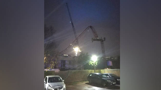 The crane collapsed on Fassett Road in Kingston upon Thames on Tuesday evening