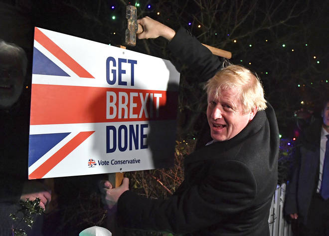 Boris Johnson with a Get Brexit Done sign