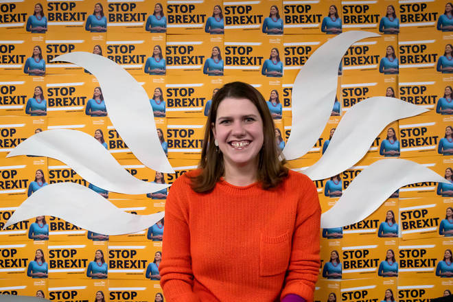 Jo Swinson poses in front of her party's Stop Brexit logo