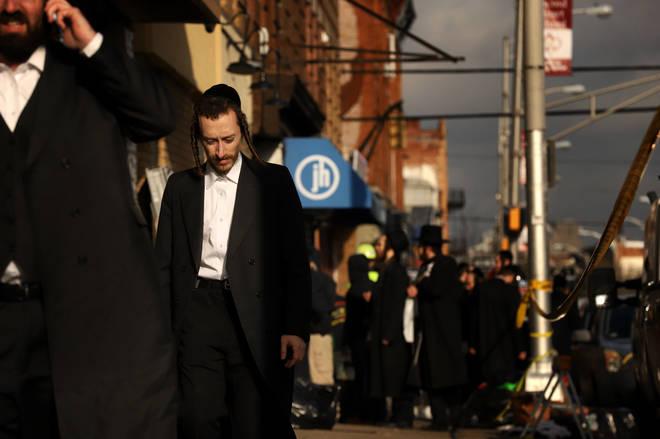 Members of the Jewish community gather around the JC Kosher Supermarket