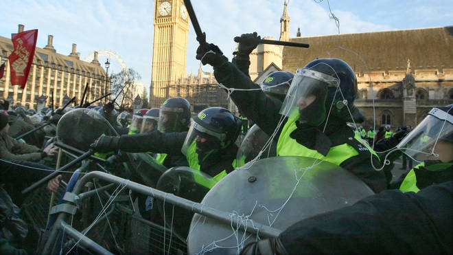 Riot police in Parliament Square during the protests