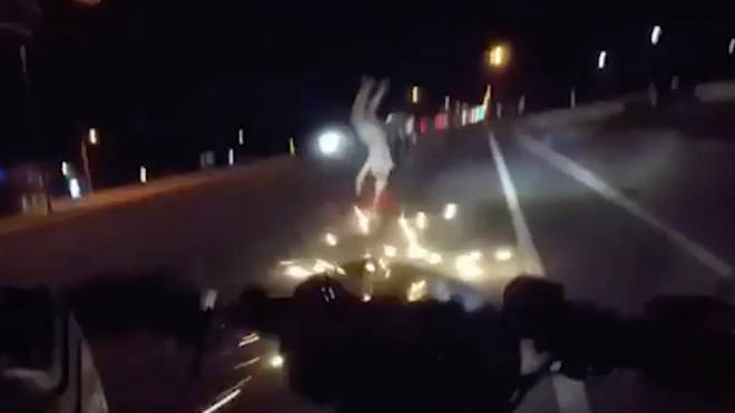Sparks could be seen flying as the biker was sent into a somersault
