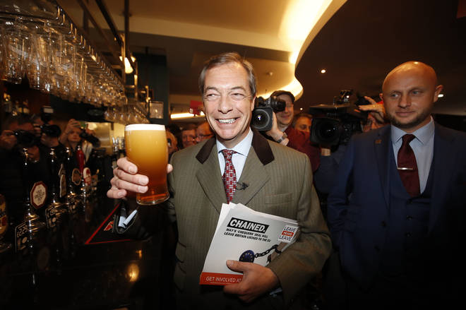 Nigel Farage, who Tim Martin supported in the election, leaving a Wetherspoons pub