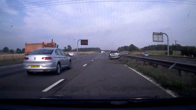 The moment after the Mini was sent flying across the motorway after a white Mercedes smashed into it.