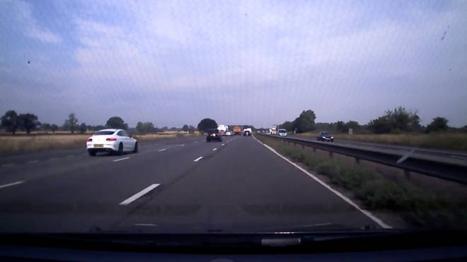 The white Mercedes seen in the inside lane moments before colliding with the Mini