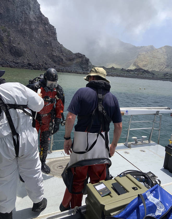 Rescue workers search for bodies in the surrounding water