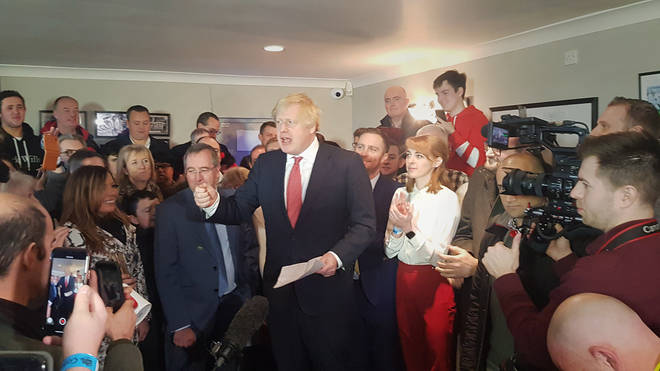 Boris Johnson celebrates with his supporters