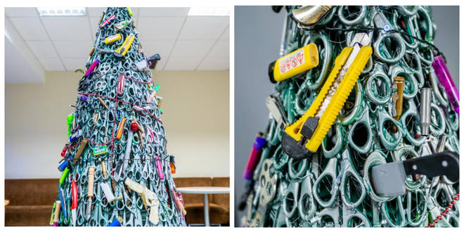 The tree contains hundreds of knives, lighters and scissors