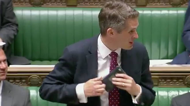 Gavin Williamson had to pull the phone out of his suit jacket pocket
