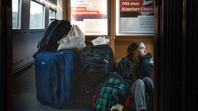 The climate activist pictured herself sitting on the floor of the train