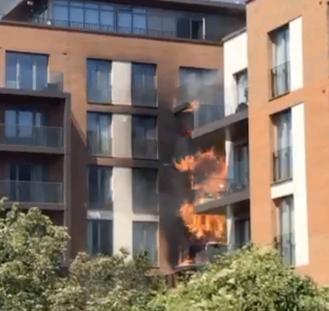 Fire engulfs several balconies at a block of flats in West Hamstead