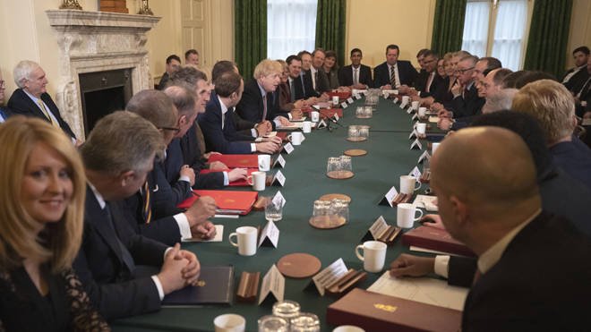 Boris Johnson speaks during his first cabinet meeting as Prime Minister