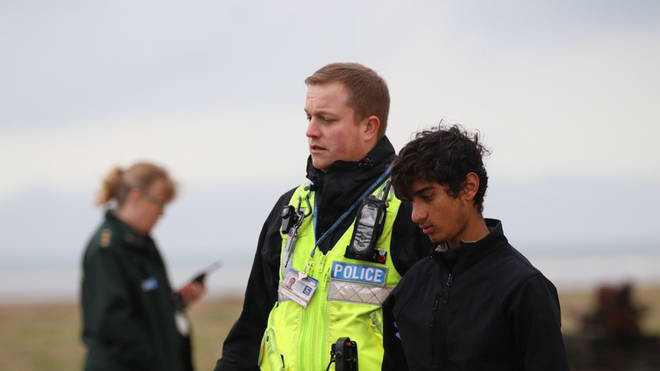 Migrants being led away by Border Force agents on a beach near Dover, as a total of 39 were detained after four boats were intercepted attempting to cross the English Channel in November
