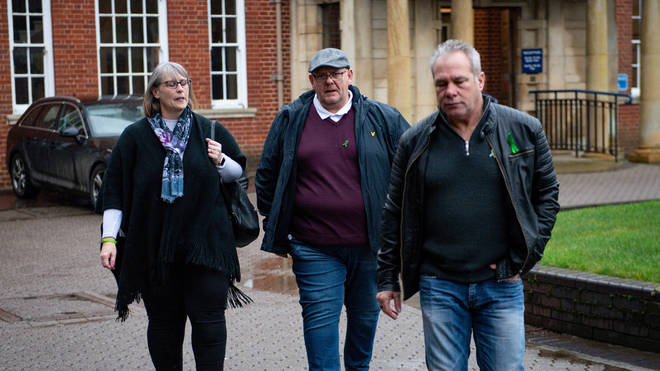 Harry Dunn's stepmother Tracey Dunn, father Tim Dunn and stepfather Bruce Charles, leave Northamptonshire Police HQ, following a meeting with Chief Constable