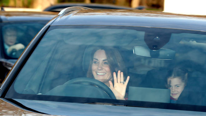 The Duchess of Cambridge and her daughter Princess Charlotte arrive for the Queen's Christmas lunch