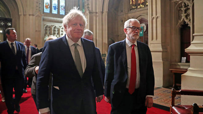 Boris Johnson and Jeremy Corbyn walk side-by-side through the Commons