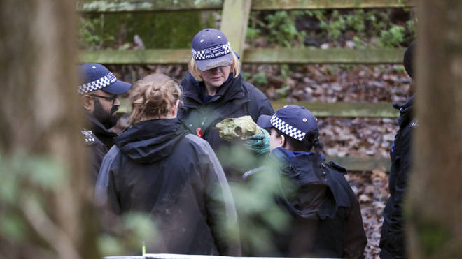 Police forensics teams search ditches and woodland at a site near Hedgerley Lane to the north of the M40