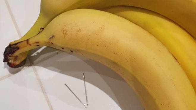 The boy bit into a banana which had a long needle inside it