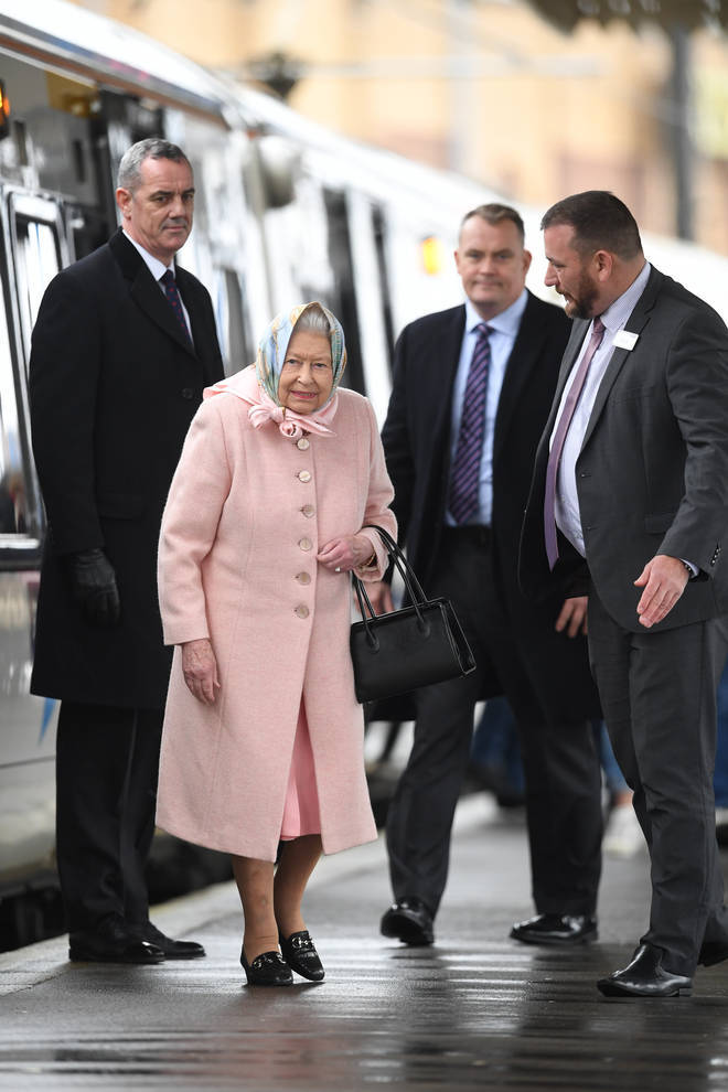 Queen Elizabeth II arrives at King's Lynn railway station in Norfolk, after travelling from London at the start of her traditional Christmas break
