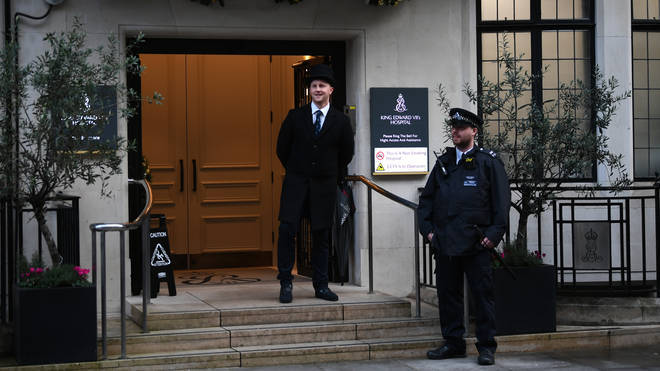 A police officer outside the King Edward VII's Hospital