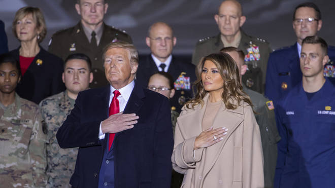 US President Donald J. Trump and First Lady Melania Trump participate in the signing ceremony for the National Defense Authorization Act in Maryland US