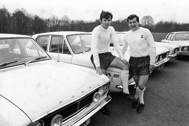 Tottenham Hotspur and England's Martin Peters (left) and Alan Mullery (right) pose with their new Ford Cortinas