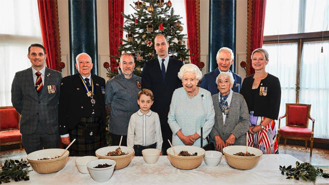 Veterans Liam Young, Colin Hughes, Alex Cavaliere, Barbra Hurman and Lisa Evans pose alongside the royal family in the Music Room at Buckingham Palace