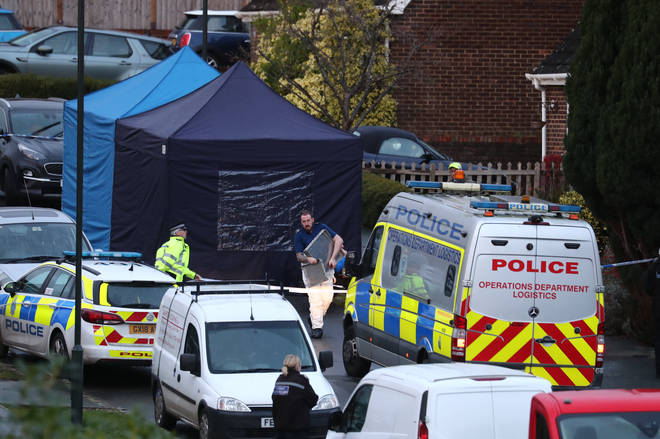 Police at a scene in Hazel Way, Crawley Down, West Sussex, where two people are feared dead after a reported stabbing.