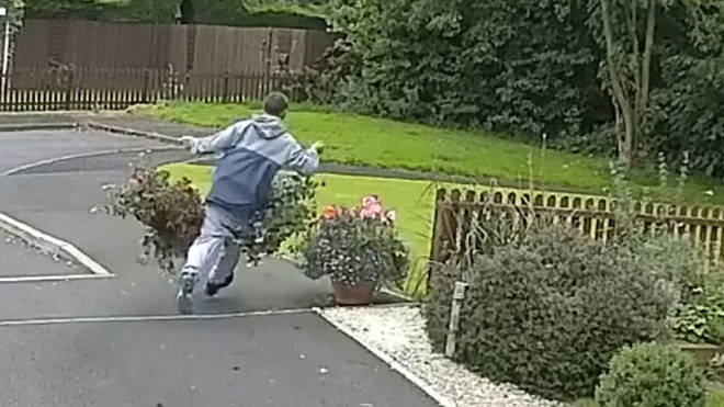 Man has a trouser mishap as he steals two big hanging baskets