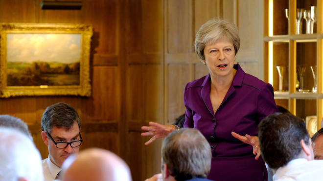 Theresa May speaking to Cabinet Members at Chequers