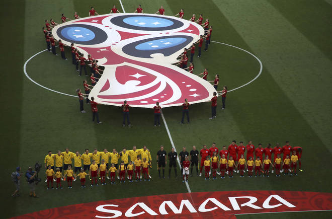 The England football team stand besides the Swedish team ahead of their quarterfinal match in the World Cup